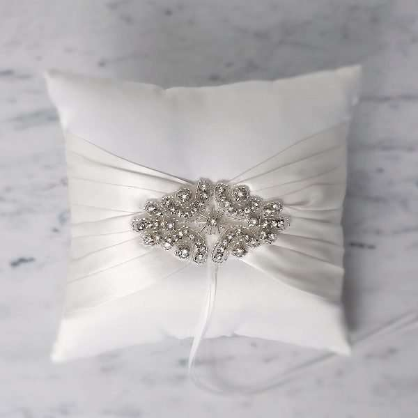 White cushion ring pillow with ivory and crystal trim